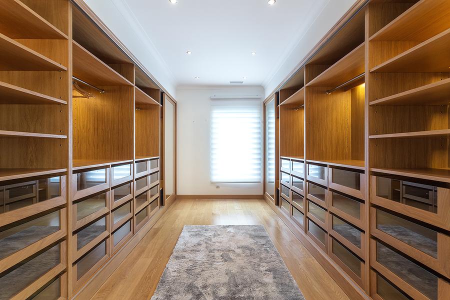 large wooden empty walk in closet