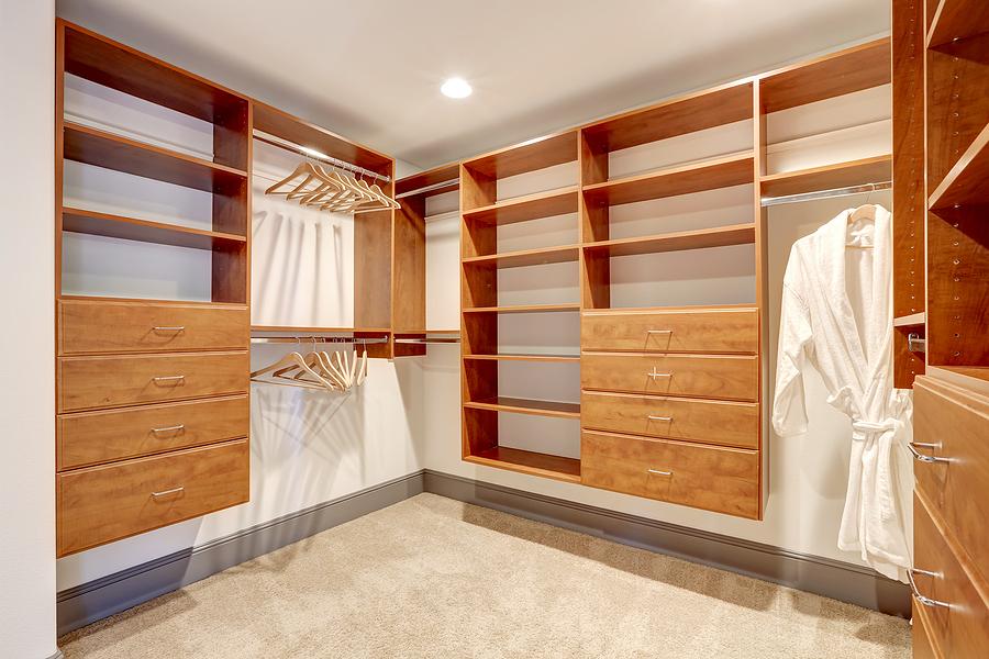empty wooden walk in closet
