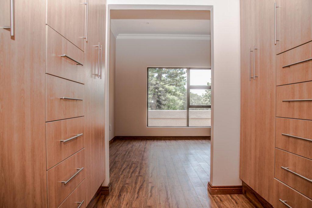 wood walk in empty closet